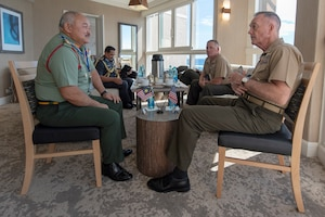 Joint Chiefs chairman and senior enlisted advisor talk on Bargram Airfield flight line.