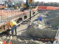A Contractor installs rebar for the Price Landfill Groundwater Treatment Plant concrete foundation. The USACE Philadelphia District constructed the facility on behalf of the Environmental Protection Agency. Groundwater treatment and monitoring are ongoing.