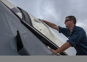 Staff Sgt. Jacob Bonner, a 162nd Wing egress technician, Arizona Air National Guard, cleans the canopy of an F-16C Fighting Falcon at Namest Air Base, Czech Republic. Maintainers clean the aircraft canopy before each sortie to ensure the pilot has a clean line of sight while flying. Ample Strike is a Czech Republic led, multi-national live exercise that offers advanced air/land integration training to Joint Terminal Attack Controllers (JTACs) and Close Air Support (CAS) aircrews. The aircraft maintenance accomplished by the maintainers enable the United States forces' to respond quickly to support and defend our allies. (U.S. Air National Guard photo by Staff Sgt. George Keck)