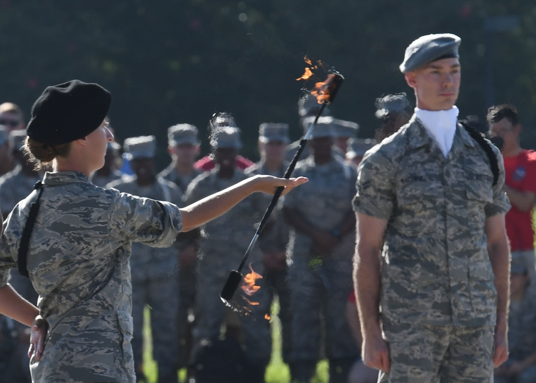 "U.S. Air Force Airmen 1st Class Laura Hinson and Michael Makowski, 335th Training Squadron freestyle drill team members, perform during the 81st Training Group drill down on the Levitow Training Support Facility drill pad at Keesler Air Force Base, Mississippi, Sept. 7, 2018. Airmen from the 81st TRG competed in a quarterly open ranks inspection, regulation drill routine and freestyle drill routine. The 335th TRS ""Bulls"" took first place in each category this quarter. (U.S. Air Force photo by Kemberly Groue)"