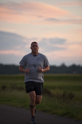 """William O'Meara, 14th Civil Engineer Squadron Fire Emergency Services Assistant Fire Chief, runs Aug. 29, 2018, on Columbus Air Force Base, Mississippi. O'Meara is a member of the Air Force Enlisted Village Marathon Team who's running the marathon for """"Mom"""".  (U.S. Air Force photo by Airman 1st Class Keith Holcomb)"""