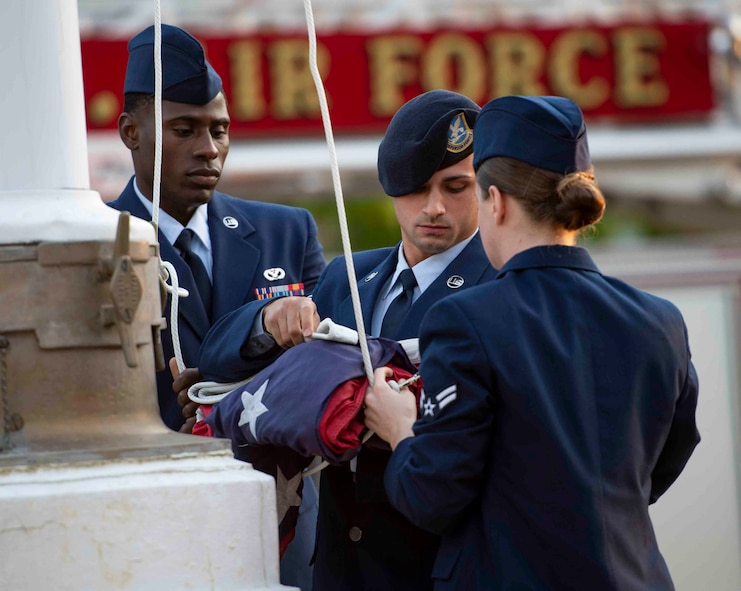 Airman Leadership School students raise the flag during a 9/11 memorial ceremony, Sept. 11, 2018, at Scott Air Force Base, Illinois. The flag was flown at half-staff in recognition of Patriot Day, a national day of mourning meant to honor the 2,996 victims of the 2001 terrorist attacks. (U.S. Air Force photo by Airman 1st Class Tara Stetler)