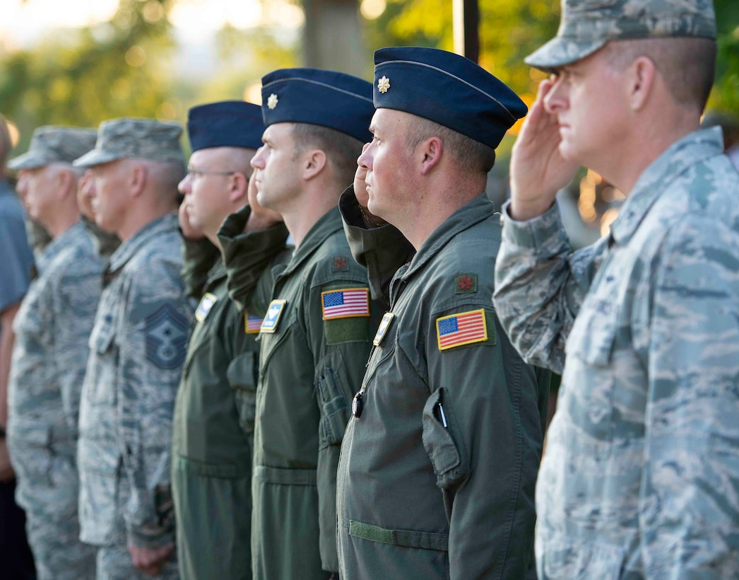 Scott Airmen salute the flag during a 9/11 memorial ceremony, Sept. 11, 2018, at Scott Air Force Base, Illinois. Following the raising of the flag, ceremony attendees remembered the victims of the 2001 terrorist attacks by participating in a moment of silence. (U.S. Air Force photo by Airman 1st Class Tara Stetler)
