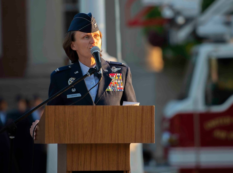 Col. Leslie Maher, 375th Air Mobility Wing commander, spoke during a 9/11 memorial ceremony, Sept. 11, 2018, at Scott Air Force Base, Illinois. Maher was working at the Pentagon at the time of the 2001 terrorist attacks. (U.S. Air Force photo by Airman 1st Class Tara Stetler)