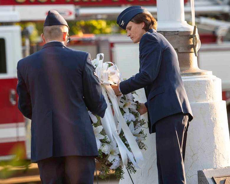 Col. Leslie Maher, 375th Air Mobility Wing commander, lays a wreath during a 9/11 memorial ceremony, Sept. 11, 2018, at Scott Air Force Base, Illinois. The wreath was meant to honor the 2,996 victims of the 2001 terrorist attacks. (U.S. Air Force photo by Airman 1st Class Tara Stetler)