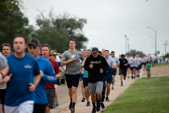 Airmen run at the 2nd Annual Suicide Prevention 5K at Cannon Air Force Base, N.M., Sept. 07, 2018. There is one death by suicide every 12 minutes in the U.S. This event was held to bring attention to these facts. (U.S. Air Force Photo by Airman 1st Class Gage Daniel)