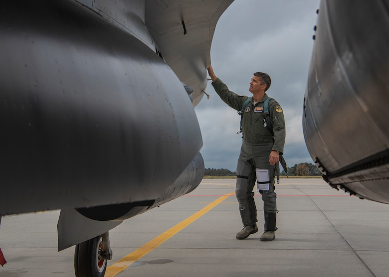 Colonel Allen Kinnison, 162nd Operations Group commander, Arizona Air National Guard, completes his pre-flight inspection of an F-16C Fighting Falcon at Namest Air Base, Czech Republic. Pilots accomplish a pre-flight inspection of each aircraft they will fly to ensure it is ready and safe for flight. Ample Strike is a Czech Republic led, multi-national live exercise that offers advanced air/land integration training to Joint Terminal Attack Controllers (JTACs) and Close Air Support (CAS) aircrews. The forward presence of the 162nd Wing, Arizona Air National Guard aircraft and Airmen in Europe allows the United States to work closely with our allies and partners to develop and improve interoperobility and maintain regional security. (U.S. Air National Guard photo by Staff Sgt. George Keck)