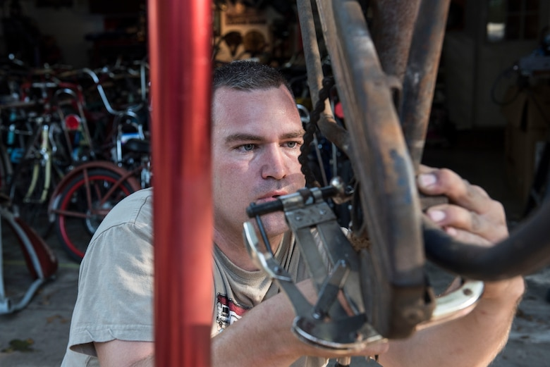 U.S. Air Force Staff Sgt. Patrick Lewis, 20th Equipment Maintenance Squadron aircraft structural maintenance mechanic, works on a bicycle at his home in Sumter, S.C., Sept. 10, 2018.