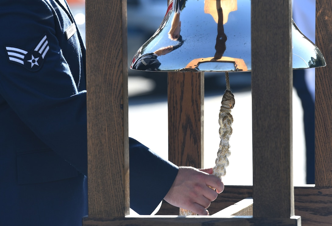U.S. Air Force Senior Airman Zachary Slater, 81st Infrastructure Division firefighter, rings a tribute bell during a 9/11 ceremony in front of the 81st Training Wing headquarters building at Keesler Air Force Base, Mississippi, Sept. 11, 2018. Seventeen years ago on Sept. 11, 2001, 19 terrorists simultaneously hijacked four passenger jets; flying one into the Pentagon and two into the World Trade Center in New York City, New York, and one crashing outside of Shanksville, Pennsylvania. A total of 2,996 people were killed in the attacks. (U.S. Air Force photo by Kemberly Groue)