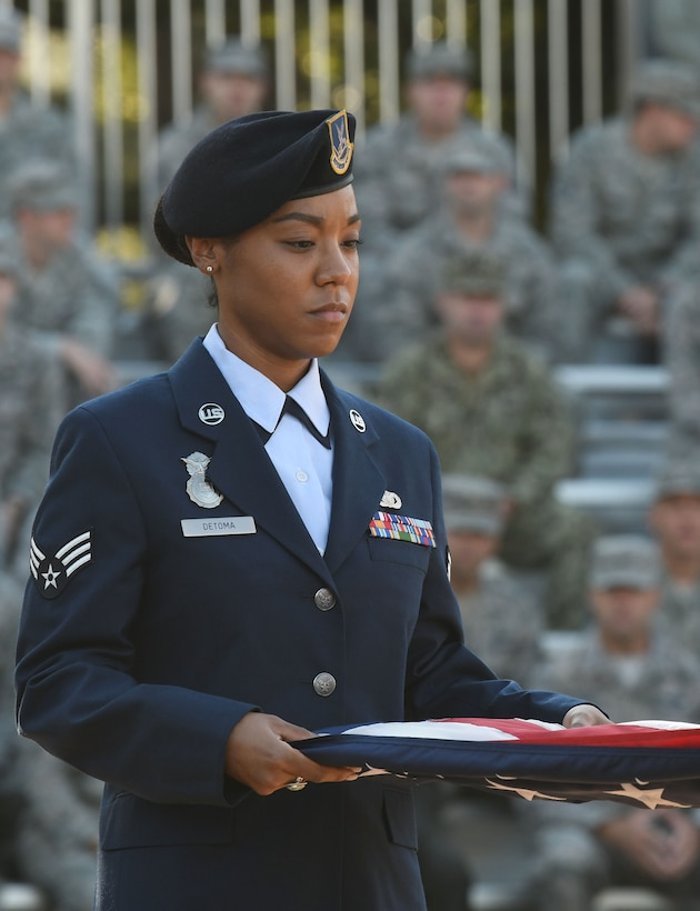 U.S. Air Force Senior Airman Jexsira Detoma, 81st Security Forces Squadron patrolman, participates in a 9/11 ceremony in front of the 81st Training Wing headquarters building at Keesler Air Force Base, Mississippi, Sept. 11, 2018. The event, attended by Keesler Airmen, Sailors, Marines and civilians, honored those who lost their lives during the 9/11 attacks. (U.S. Air Force photo by Kemberly Groue)