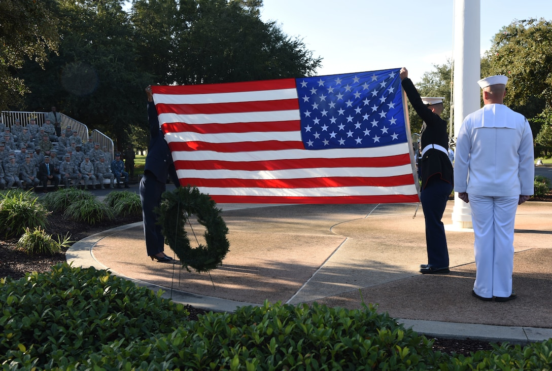 Keesler Airmen, Sailors and Marines participate in a 9/11 memorial ceremony in front of the 81st Training Wing headquarters building at Keesler Air Force Base, Mississippi, Sept. 11, 2018. The event honored those who lost their lives during the 9/11 attacks. (U.S. Air Force photo by Kemberly Groue)
