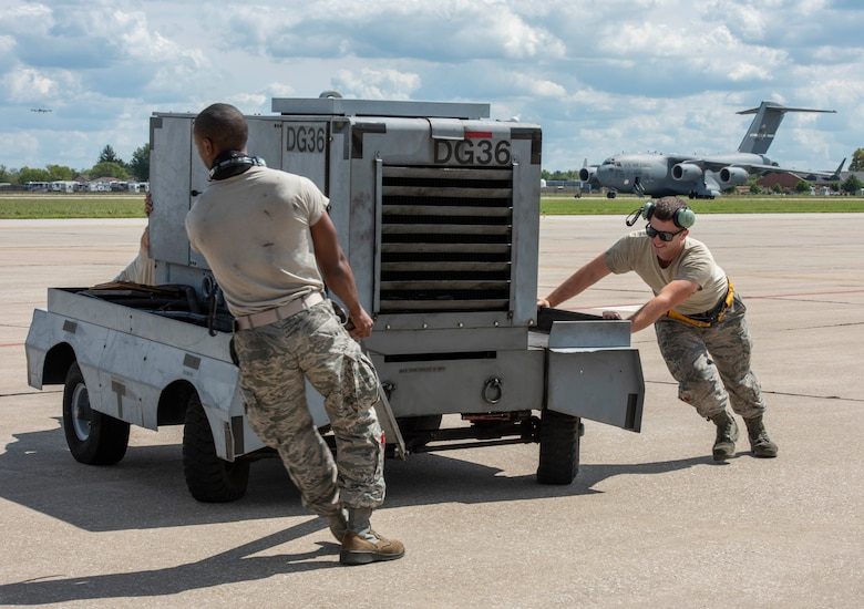 Airmen from Joint Base Charleston and Scott AFB team up to unload a C-17 Globemaster III assigned to the 437th Airlift Squadron during Hurricane Florence evacuation efforts, Sept. 11, 2018, at Scott AFB, Illinois. More than 1 million people have been ordered to evacuate Virginia, North Carolina and South Carolina in preparation of the Category 4 storm. (U.S. Air Force photo by Senior Airman Melissa Estevez)