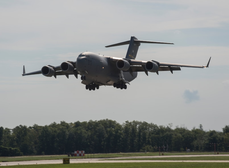 A C-17 Globemaster III from Joint Base Charleston, South Carolina lands at Scott AFB, Illinois, Sept. 11, 2018. Scott AFB and Mid-America Airport are expected to host a fleet of C-17's assigned to the 437th Airlift Squadron that were evacuating Hurricane Florence, a Category 4 storm heading toward the East Coast. (U.S. Air Force photo by Airman 1st Class Nathaniel Hudson)