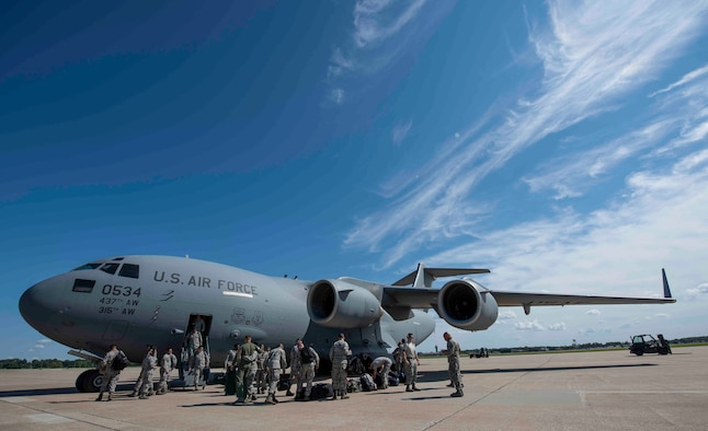 Airmen from Joint Base Charleston disembark a C-17 Globemaster III, Sept. 11, 2018, at Scott AFB, Illinois. Scott AFB teamed up with Mid-America Airport to host a fleet of C-17s assigned to the 437th Airlift Wing during Hurricane Florence evacuation efforts. (U.S. Air Force photo by Airman 1st Class Tara Stetler)