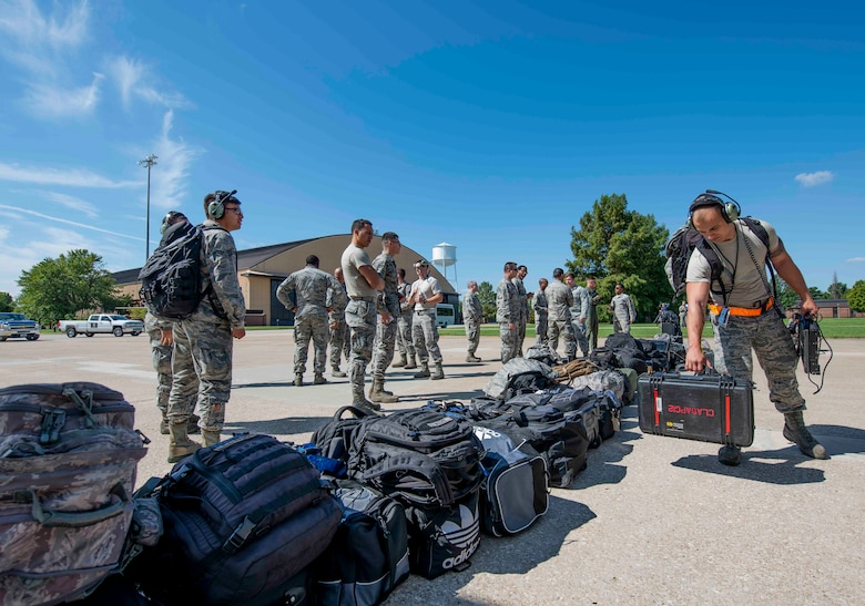 Airmen with Joint Base Charleston unload their gear off a C-17 Globemaster III assigned to the 437th Airlift Wing during Hurricane Florence evacuation efforts, Sept. 11, 2018, at Scott AFB, Illinois. The purpose of the evacuation is to protect people and assets from the storm. (U.S. Air Force photo by Airman 1st Class Tara Stetler)