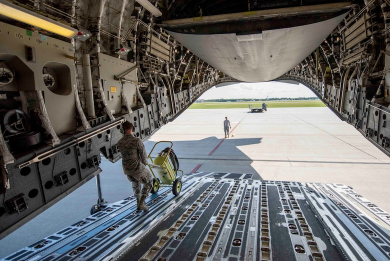 Airmen from Joint Base Charleston and Scott AFB team up to unload a C-17 Globemaster III assigned to the 437th Airlift Squadron during Hurricane Florence evacuation efforts, Sept. 11, 2018, at Scott AFB, Illinois. More than 1 million people have been ordered to evacuate Virginia, North Carolina and South Carolina in preparation of the Category 4 storm. (U.S. Air Force photo by Airman 1st Class Tara Stetler)