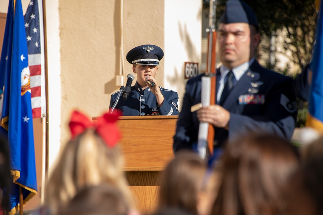 Airman 1st Class Kayla Highsmith, Band of the Golden West vocalist, sings the National Anthem during the Remembrance Day Freedom Walk at Travis Air Force Base, Calif., Sep. 11, 2018. The walk commemorates those who lost their lives on 9/11. (U.S. Air Force photo by Heide Couch)