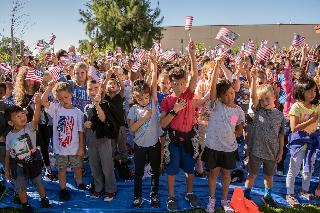 Children from Travis Air Force Base, Calif., elementary schools attend the Remembrance Day Freedom Walk, Sep. 11, 2018. The walk commemorates those who lost their lives on 9/11.(U.S. Air Force photo by Heide Couch)