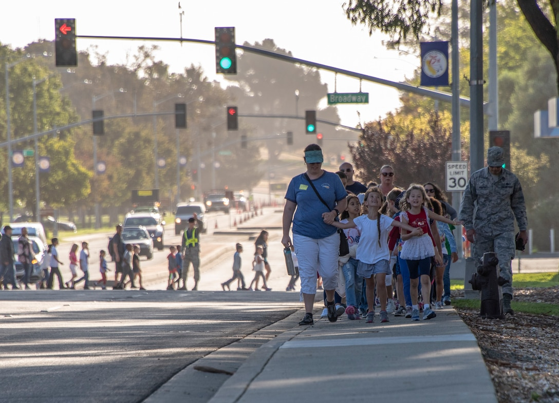 Students from Travis Air Force Base elementary schools participate in a Freedom Walk, Sept. 11, 2018. The walk commemorates those who lost their lives on 9/11. (U.S. Air Force photo by Heide Couch)