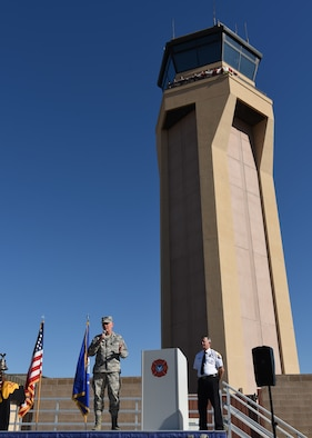 Col. Robert Sylvester, 56th Mission Support Group commander, addresses a crowd at the 9/11 Remembrance Ceremony before a Tribute Tower Climb Sept. 11, 2018 at Luke Air Force Base, Ariz. The Tribute Tower Climb was held in Luke's air traffic control tower where Thunderbolts climbed 10 flights of stairs to the top of the tower to hang 411streamers representing the emergency responders who lost their lives during the Sept. 11, 2001 attacks on the United States. (U.S. Air Force photo by Airman 1st Class Aspen Reid)