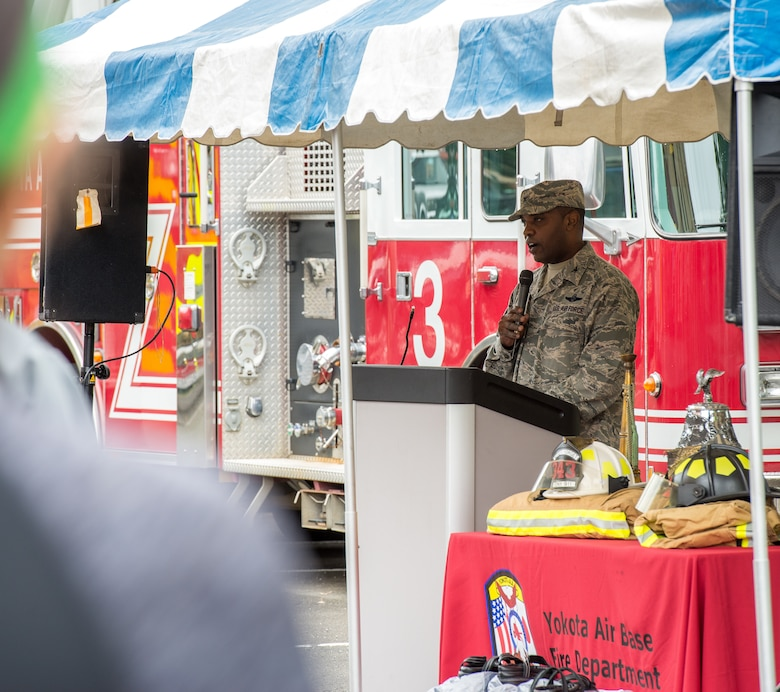 Col. Otis T. Jones, 374th Airlift Wing commander, speaks at the opening ceremony