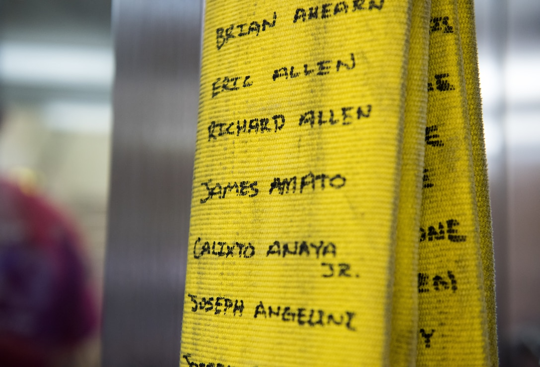 Names of first responders who died during the September 11th attack are displayed on a firehose