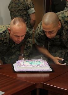 USAG CAMP HUMPHREYS, Korea – Master Sgt. Justin M. Harding, G3 operations chief, and Staff Sgt. Michael J. Hoffman, G4 engineer, celebrate their birthday here, 6 Sept. The Marines of U.S. Marine Corps Forces Korea surprised Harding and Hoffman with the cake. (U.S. Marine Corps photos by Sgt. Nathaniel Hanscom/Released)