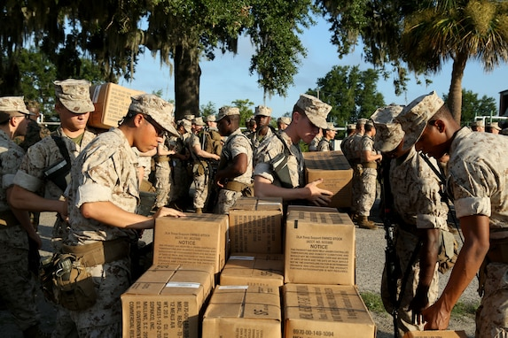Marines pack boxes as the prepare to evacuate from a base in South Carolina.