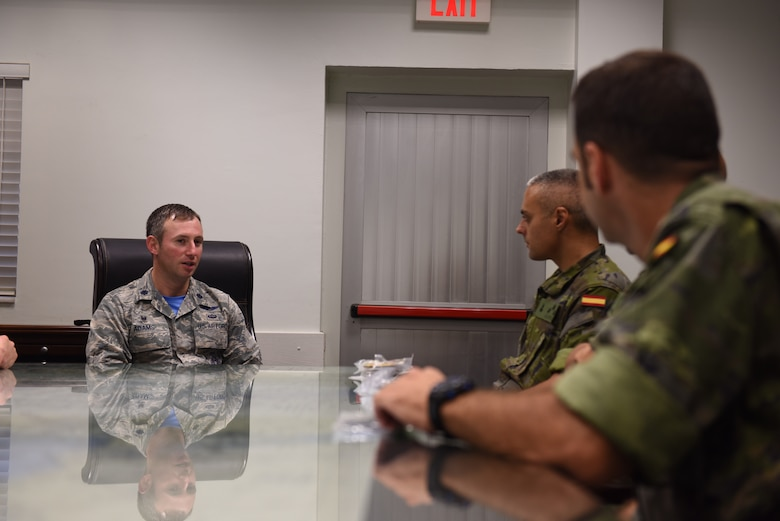 U.S. Air Force Lt. Col. Isaac Adams, 728th Air Mobility Squadron commander, briefs members of the Spanish Army on the unit's mission at Incirlik Air Base, Turkey, Sept. 7, 2018.