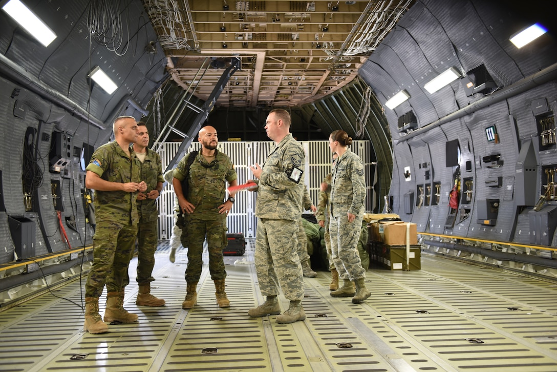 U.S. Air Force Master Sgt. Gene Harper, 728th Air mobility aerial terminal operations center section Chief, gives members of the Spanish Army a tour of a U.S. Air Force C-5M Super Galaxy, at Incirlik Air Base, Turkey, Sept. 7, 2018