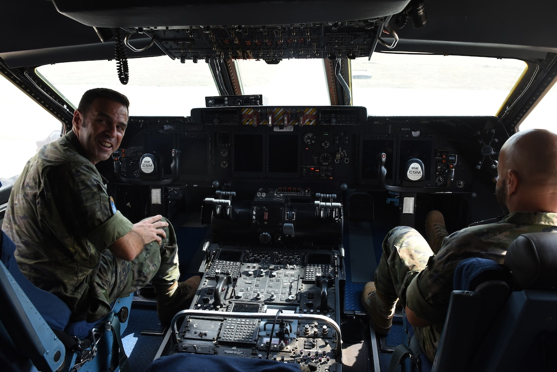 Members of the Spanish Army sit in the cockpit of a U.S. Air Force C-5M Super Galaxy at Incirlik Air Base, Turkey, Sept. 7th, 2018.