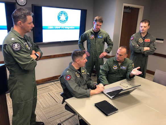 "Members of the Navy Physiological Episodes Action Team and Air Force PEAT listen to a discussion between Rear Adm. Fredrick R. ""Lucky"" Luchtman (left) and Air Force Brig. Gen. Edward L. ""Hertz"" Vaughan (right) as they lay the ground work for the Joint Physiological Episodes Action Team, or J-PEAT. (U.S. Navy Courtesy Photo by Scot Cregan)"