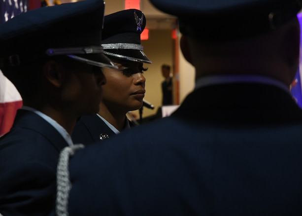 94th Airlift Wing honor guard members set up the prisoner of war and missing in action memorial table at Dobbins Air Reserve Base, Sept. 8, 2018. The 94th AW hosted an Air Force Ball, where attendees honored POW and MIA members through a ceremony. (U.S. Air Force Photo by Staff Sgt. Miles Wilson)
