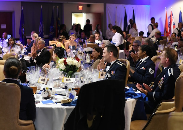 Air Force Ball attendees clap as Col. Wayne Waddell, United States Air Force retired, finishes speaking at Dobbins Air Reserve Base, Ga, Sept. 8, 2018. During the ball, which was hosted by the 94th Airlift Wing, Waddell spoke about his time as a prisoner of war in Vietnam, and answered questions that any attendees may have had with regards to his imprisonment. (U.S. Air Force Photo by Staff Sgt. Miles Wilson)