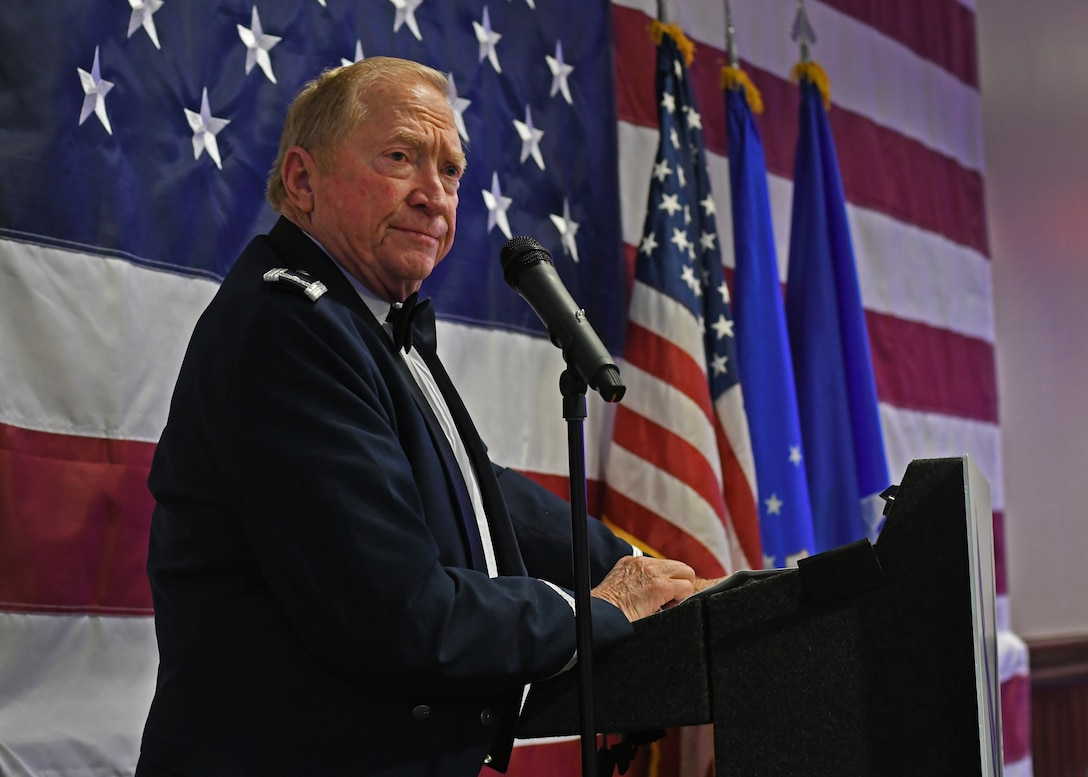 Col. Wayne Waddell, United States Air Force retired, speaks at an Air Force Ball hosted by the 94th Airlift Wing at Dobbins Air Reserve Base, Sept. 8, 2018. Waddell spent six years as a prisoner of war in Vietnam, and spoke about how he was shot down and captured. (U.S. Air Force Photo by Staff Sgt. Miles Wilson)