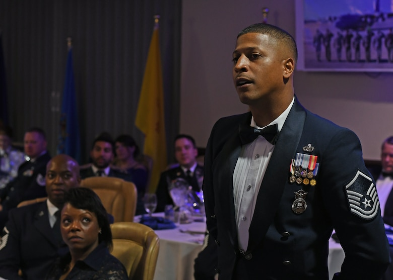 A member of the 94th Security Forces Squadron asks guest speaker, Col. Wayne Waddell, U.S. Air Force retired, a question at the Air Force Ball hosted by the 94th Airlift Wing at Dobbins Air Reserve Base, Sept. 8, 2018. Waddell spent six years as a prisoner of war in Vietnam, and spoke about how he was shot down and captured. (U.S. Air Force Photo by Staff Sgt. Miles Wilson)