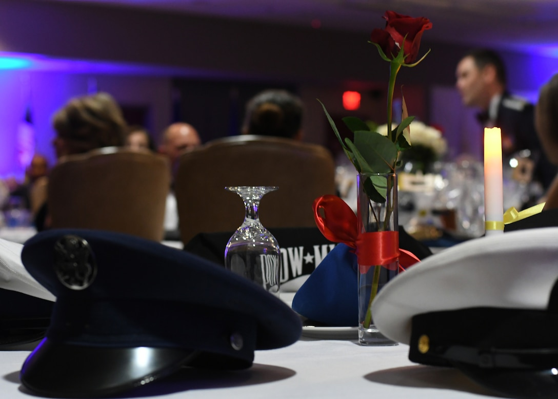 A prisoner of war and missing in action memorial table was placed during an Air Force Ball hosted by the 94th Airlift Wing at Dobbins Air Reserve Base, Ga, Sept. 8, 2018. During the ball, guest speaker Col. Wayne Waddell, United States Air Force retired, talked about his time as a prisoner of war in Vietnam, and allowed the attendees to ask questions about his imprisonment. (U.S. Air Force Photo by Staff Sgt. Miles Wilson)