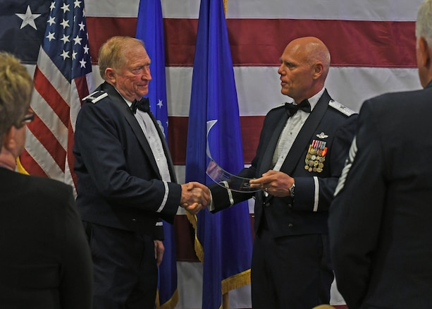 Col. Wayne Waddell, United States Air Force retired, accepts an award of appreciation from Brig. Gen. Richard Kemble, 94th Airlift Wing commander, at Dobbins Air Reserve Base, Ga, Sept. 8, 2018. Waddell was a guest speaker at an Air Force Ball hosted by the 94th AW, and spoke about his time as a prisoner of war in Vietnam. (U.S. Air Force Photo by Staff Sgt. Miles Wilson)
