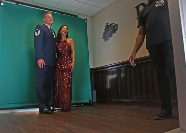 """Air Force Ball attendees take photos at a """"selfie station"""" at Dobbins Air Reserve Base, Ga, Sept. 8, 2018. The 94th Airlift Wing hosted an Air Force Ball, and invited Col. Wayne Waddell, United States Air Force retired, to speak at the event, where he told about his time spent as a prisoner of war in Vietnam. (U.S. Air Force Photo by Staff Sgt. Miles Wilson)"""