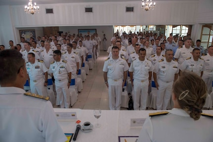 Multinational sailors stand for the Colombian national anthem during the closing ceremony of UNITAS 2018