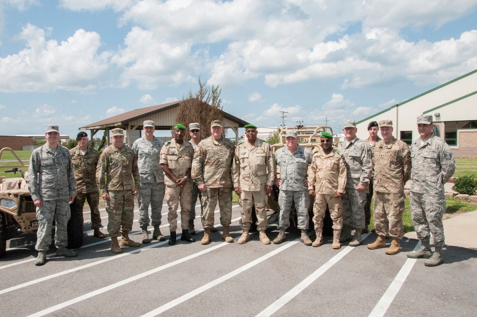 Service members from the Niger Armed Forces and Indiana National Guard pose for a group photo at the conclusion of a State Partnership Program meeting at Hulman Field Air National Guard Base, Terre Haute, Indiana, Aug. 28, 2018.