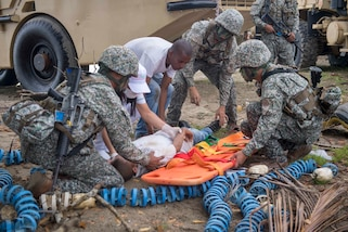 Colombian marines treat a simulated casualty during a humanitarian assistance training exercise for UNITAS 2018.