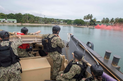 A landing craft utility prepares to land on the beach in Cartagena, Colombia for a humanitarian assistance training exercise