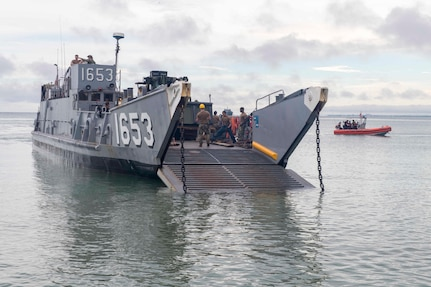 A landing craft utility attached to Beachmaster Unit 2 prepares to land on the beach in Cartagena, Colombia for a humanitarian assistance training exercise.