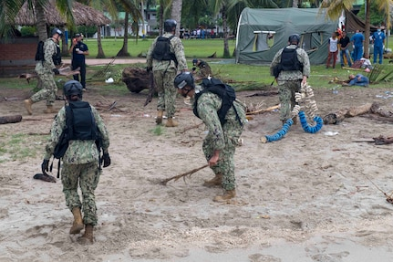 Sailors prepare a beach for landing in Cartagena, Colombia for a humanitarian assistance training exercise.
