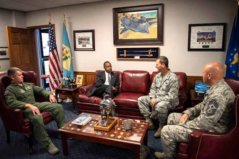 Dr. Ben Carson, Housing and Urban Development secretary, meets with Col. Craig Peters (left), 512th Airlift Wing commander, Col. Joel Safranek (middle right), 436th Airlift Wing commander, and Chief Master Sgt. Anthony Green (right), 436th Airlift Wing command chief, prior to a 9/11 Memorial Service Sept. 11, 2018, at Dover Air Force Base, Delaware. Carson was briefed by the wing commander on the total force mission Dover Airmen support.
