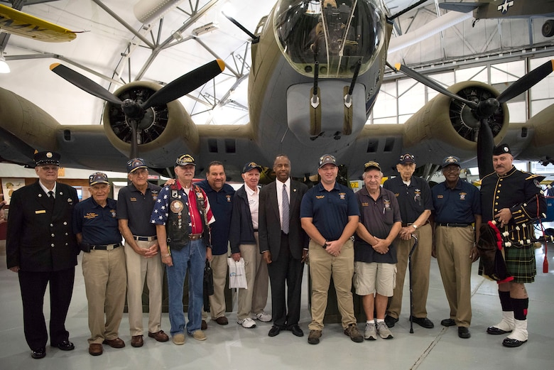 Dr. Ben Carson, Housing and Urban Development secretary, poses for a photo with Air Mobility Command Museum volunteers and participants of a 9/11 Memorial Service Sept. 11, 2018, at the Air Mobility Command Museum on Dover Air Force Base, Delaware. The AMC Museum features a 9/11 memorial monument, so it is the preferred location for the annual service, which commemorates the lives lost during the terrorist attacks on Sept. 11, 2001.