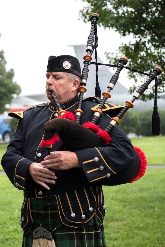 Timothy Kline, Dover Fire Pipes & Drums Corps, play Amazing Grace at the conclusion of a 9/11 Memorial Service Sept. 11, 2018, at the Air Mobility Command Museum on Dover Air Force Base, Delaware. Members of The Dover Police and Fire Pipes & Drums Corps are all volunteers who participate in various community, civic and military functions to honor retired and active police officers, firefighters and those who have lost their lives in the line of duty.