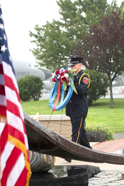 Tyler Moore, a firefighter with the Felton Fire Company, lays a wreath during a 9/11 Memorial Service Sept. 11, 2018, at the Air Mobility Command Museum's 9/11 Memorial on Dover AFB, Delaware. The museum's 9/11 Memorial includes two pieces of steel from the World Trade Center, a rock from the United Airlines Flight 93 crash site and a block from the damaged portion of the Pentagon building.