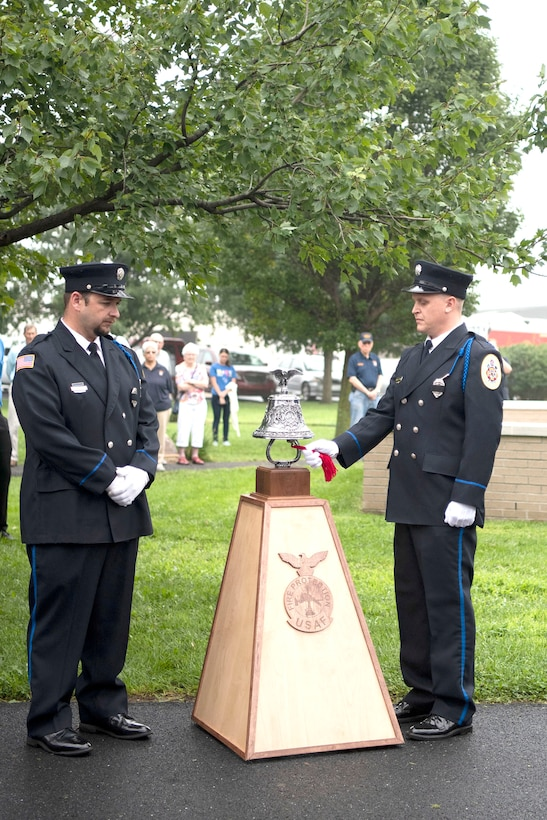 William Caiola and Adam Fluharty, members of Carlisle Fire Company in Milford, Delaware, perform a bell-ringing ceremony during a 9/11 Memorial Service Sept. 11, 2018, at the Air Mobility Command Museum on Dover Air Force Base.  The bell-ringing ceremony is a firefighter tradition that announces the death of a firefighter and commemorates their sacrifice.